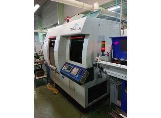 Прутковый токарный автомат продольного точения Tornos DECO 26
